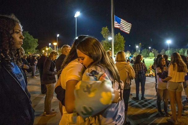 PHOTO: Mourners hug each other at a vigil held for shooting victims, Nov. 17, 2019, in Santa Clarita, California. (Apu Gomes/Getty Images)