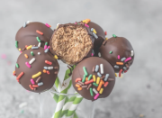 """<p>Forget wanting a slice of cake—the equal crunch and fluff of cake pops are even more satisfying. And these special ones are made of only four ingredients: dark chocolate, oats, peanut butter, and chocolate protein powder. </p><p><strong><em><a href=""""https://erinpalinski.com/high-protein-cake-pops/"""" rel=""""nofollow noopener"""" target=""""_blank"""" data-ylk=""""slk:Get the recipe from Erin Palinski-Wade »"""" class=""""link rapid-noclick-resp"""">Get the recipe from Erin Palinski-Wade »</a></em></strong></p>"""