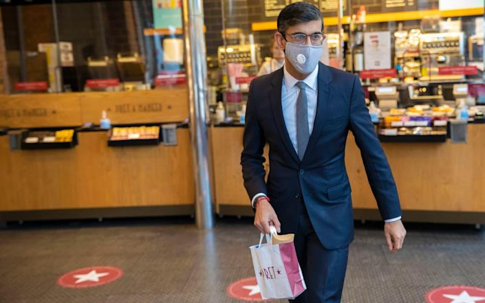 Masking up: Rishi dons a mask for Pret