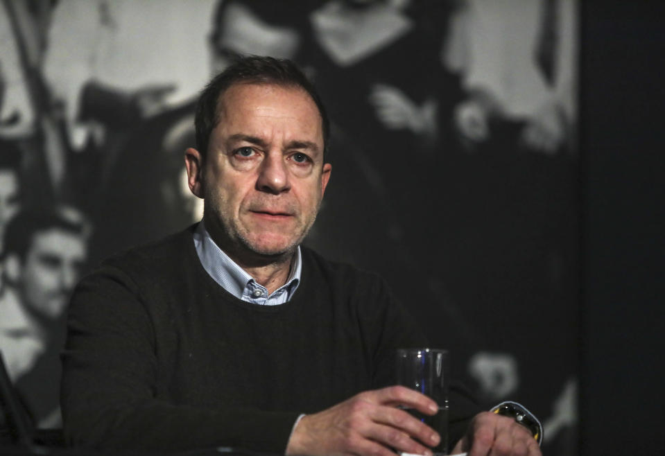 FILE - In this Tuesday, Jan. 21, 2020, file photo Dimitris Lignadis, actor and director, attends a news conference in Athens. On Saturday afternoon, Feb. 20, 2021, Lignadis, 56, turned himself in at Athens police headquarters, police said, and held pending an appearance before a magistrate. Lignadis has denied rape charges. (Dimitris Kapadais/InTime News via AP, File)