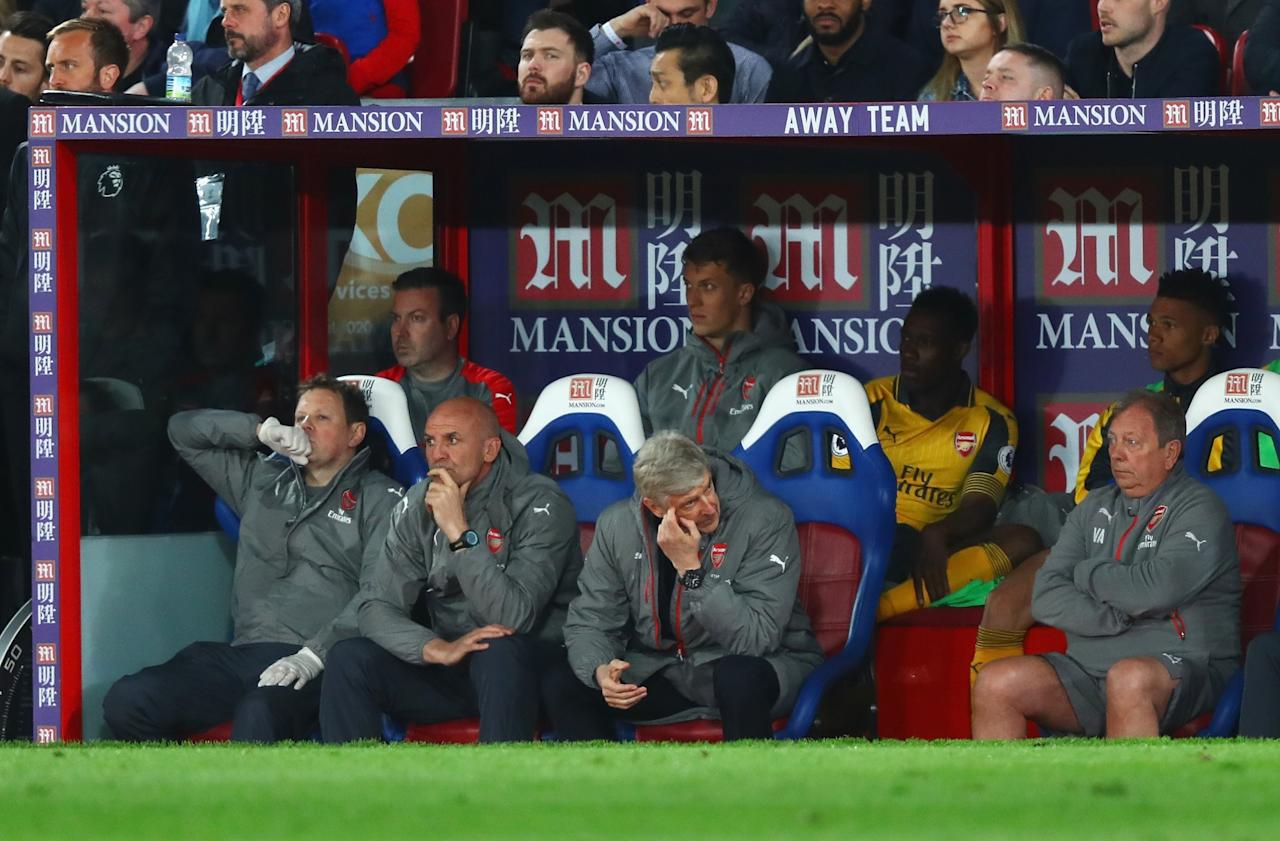 <p>Arsene Wenger can barely watch as his Arsenal side fall apart</p>