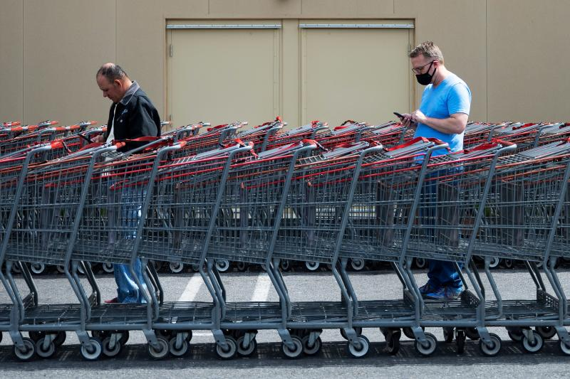 TOPSHOT - Shoppers social distance themselves as they wait in line to get into Costco in Washington, DC, on April 5, 2020. - The number of confirmed coronavirus, COVID-19, cases in the United States has topped 300,000 and there have been more than 8,100 deaths, Johns Hopkins University reported on Saturday. (Photo by JIM WATSON / AFP) (Photo by JIM WATSON/AFP via Getty Images)