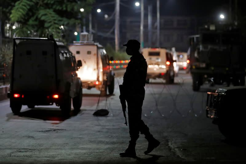An Indian security force personnel stands guard near the residence of Syed Ali Shah Geelani after his death in Srinagar