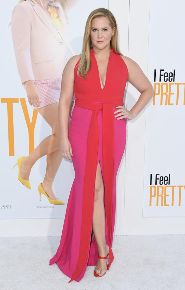 """<p>Amy Schumer looked better than ever in the pink and red gown by designer Brandon Maxwell at the premiere of her new film, """"I Feel Pretty."""" </p>"""