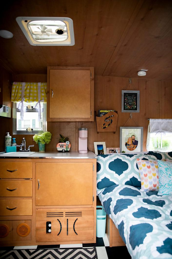 Jenna Beall Mueller and Adam Mueller's 2015 Shasta Airflyte Reissue camper features a full size bed, a three burner cooktop, microwave, refrigerator with freezer, sink, and storage.