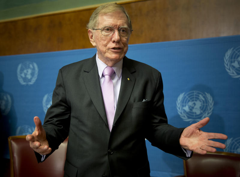 """Retired Australian judge Michael Kirby, chairperson of the commission of Inquiry on Human Rights in the Democratic People's Republic of Korea, gestures after delivering the commission's report during a press conference at the United Nations in Geneva, Switzerland, Monday, Feb. 17, 2014. A U.N. panel has warned North Korean leader Kim Jong Un that he may be held accountable for orchestrating widespread crimes against civilians in the secretive Asian nation. Kirby told the leader in a letter accompanying a yearlong investigative report on North Korea that international prosecution is needed """"to render accountable all those, including possibly yourself, who may be responsible for crimes against humanity."""" (AP Photo/Anja Niedringhaus)"""