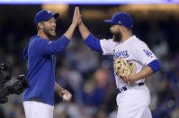 Los Angeles Dodgers' Russell Martin, whose normal position is catcher, is congratulated by Clayton Kershaw after closing out the team's baseball game against the Arizona Diamondbacks on Saturday, March 30, 2019, in Los Angeles. (AP Photo/Mark J. Terrill)
