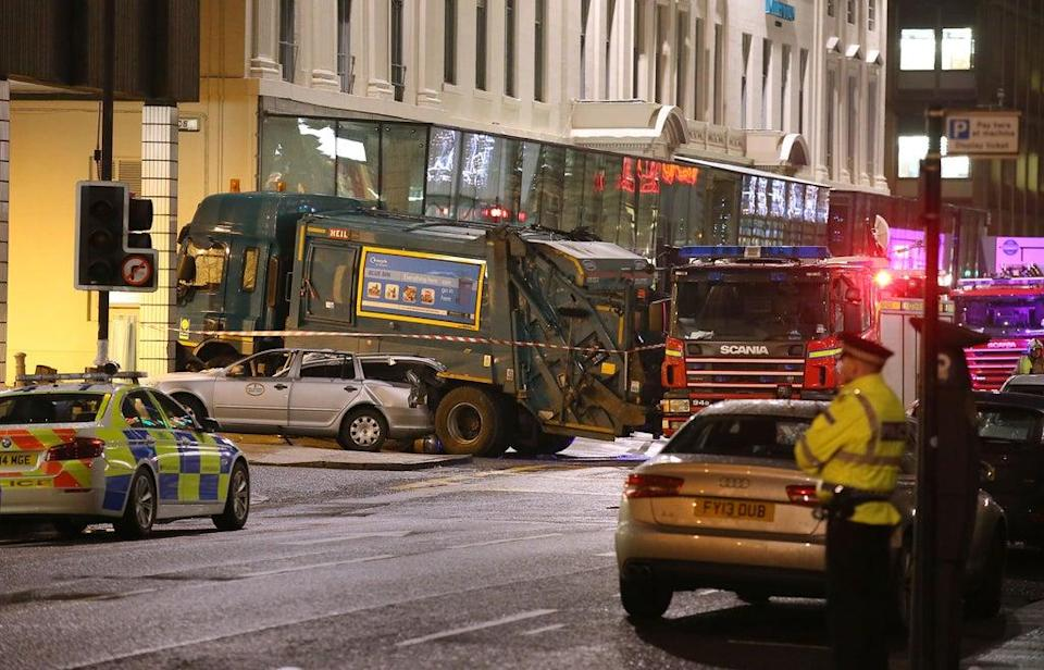 The scene in Glasgow's George Square after the out-of-control bin lorry careered through streets packed with Christmas shoppers killing six people (Andrew Milligan/PA) (PA Archive)