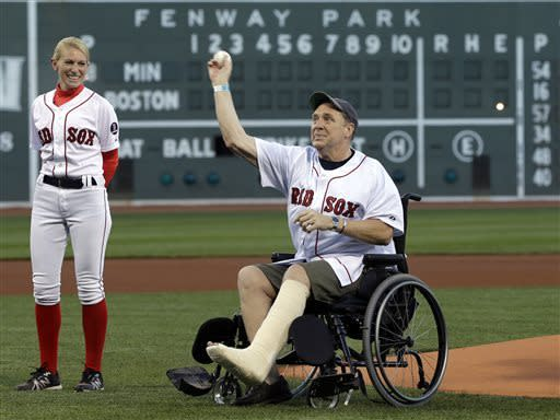 Boston Marathon bombing victim Ron Brassard of Epsom, N.H., throws out a ceremonial first pitch prior to a baseball game between the Boston Red Sox and the Minnesota Twins at Fenway Park in Boston, Tuesday, May 7, 2013. (AP Photo/Elise Amendola)