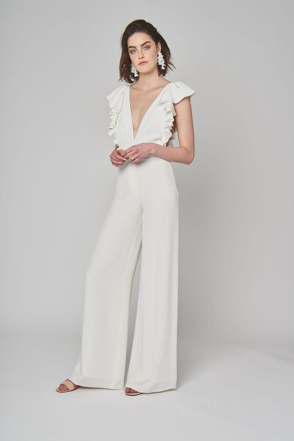<p>White ruffle jumpsuit. (Photo: Courtesy of Alexandra Grecco) </p>