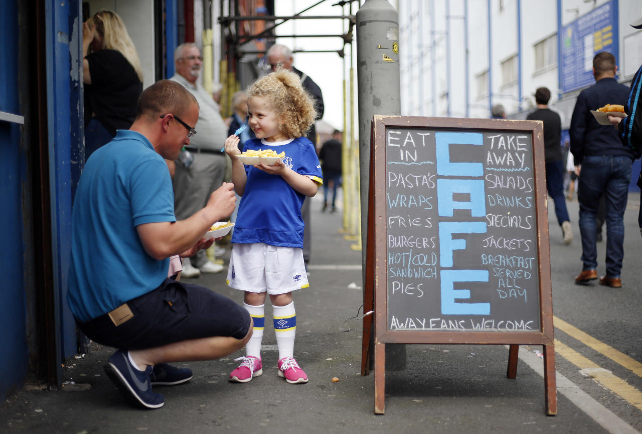 "Football Soccer Britain - Everton v Stoke City - Premier League - Goodison Park - 27/8/16 Everton fans eat hot food outside the stadium before the game Action Images via Reuters / Ed Sykes Livepic EDITORIAL USE ONLY. No use with unauthorized audio, video, data, fixture lists, club/league logos or ""live"" services. Online in-match use limited to 45 images, no video emulation. No use in betting, games or single club/league/player publications.  Please contact your account representative for further details."