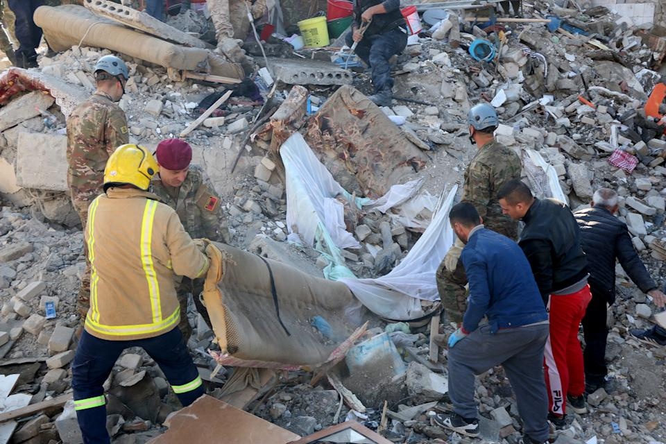 Soldiers and civilians conduct search and rescue operation at a damaged building after 6.4-magnitude earthquake hit Albania's Durres city on November 26, 2019. (Photo: Olsi Shehu/Anadolu Agency via Getty Images)