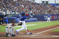 Toronto Blue Jays' Vladimir Guerrero Jr. hits a home run during the fourth inning of the team's baseball game against the Boston Red Sox on Wednesday, July 21, 2021, in Buffalo, N.Y. (AP Photo/Joshua Bessex)