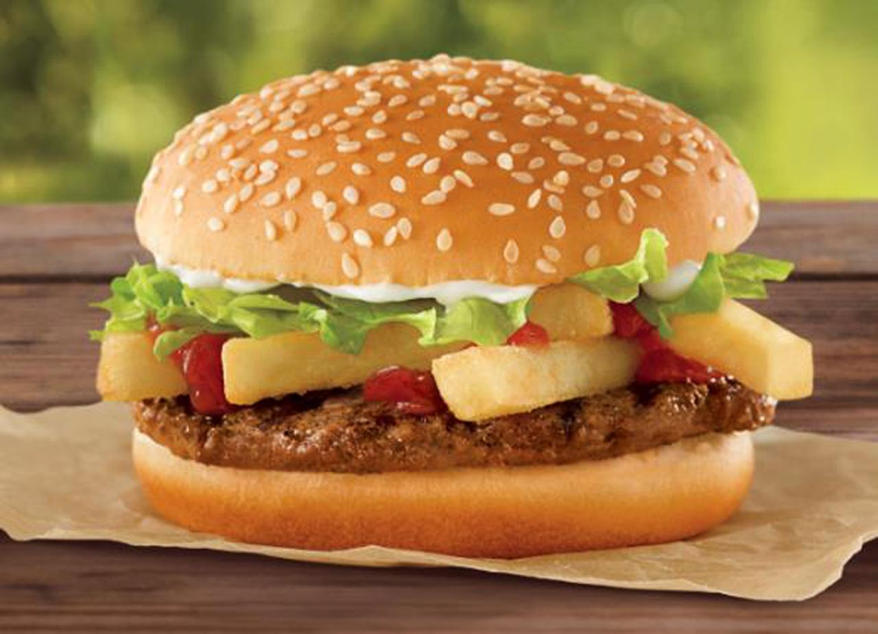 "<p> This undated photo provided by Burger King shows a a ""French Fry Burger,"" which Burger King is rolling out for $1 as the company looks to fend off a Dollar Menu push by McDonald's. (AP Photo/Burger King)"