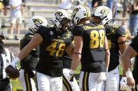 Missouri tight end Niko Hea (48) celebrates with teammate Logan Christopherson (88) after scoring during the second half of an NCAA college football game against LSU Saturday, Oct. 10, 2020, in Columbia, Mo. Missouri upset LSU 45-41. (AP Photo/L.G. Patterson)