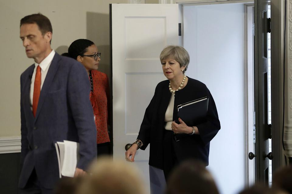 Britain's Prime Minister Theresa May (R) arrives with RSA Chief Executive Matthew Taylor (L) to deliver a speech on modern working practices at the RSA (Royal Society for the encouragement of Arts, Manufactures and Commerce) in London, on July 11, 2017. A weakened Theresa May came under fresh pressure Tuesday to soften her Brexit position, adding to uncertainty about her negotiating strategy with Brussels one year after she became Britain's leader. / AFP PHOTO / POOL / Matt Dunham        (Photo credit should read MATT DUNHAM/AFP via Getty Images)