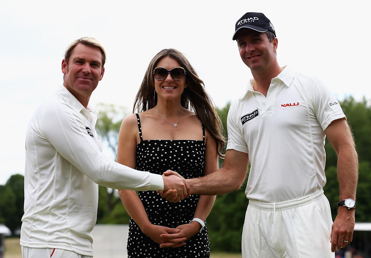 CIRENCESTER, ENGLAND - JUNE 09:  Elizabeth Hurley looks on with Shane Warne and Michael Vaughan during the Shane Warne's Australia vs Michael Vaughan's England T20 match at Circenster Cricket Club on June 9, 2013 in Cirencester, England.  (Photo by Matthew Lewis/Getty Images)