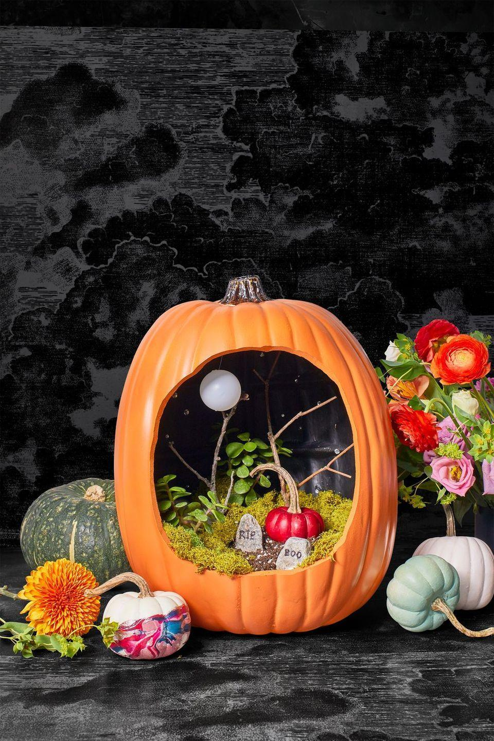 """<p>If you love nothing more than an over-the-top look, fill a carved pumpkin with everything from reindeer moss and twigs to mini headstones. Don't forget the full moon (a Ping-Pong ball that you can easily hang from a thin string).</p><p><a class=""""link rapid-noclick-resp"""" href=""""https://www.amazon.com/SuperMoss-23080-Reindeer-Moss-Preserved/dp/B01C5RTP7Y/ref=sr_1_4?tag=syn-yahoo-20&ascsubtag=%5Bartid%7C10055.g.421%5Bsrc%7Cyahoo-us"""" rel=""""nofollow noopener"""" target=""""_blank"""" data-ylk=""""slk:SHOP REINDEER MOSS"""">SHOP REINDEER MOSS</a></p>"""