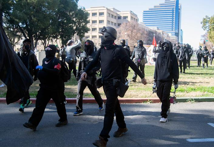 A group of Antifa protesters march toward the California State Capitol in downtown Sacramento.