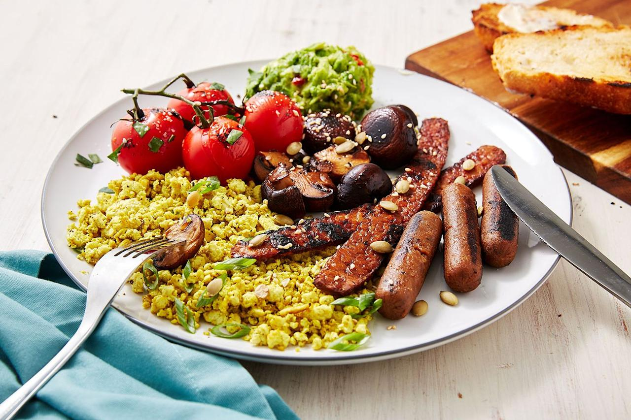 "<p>We think you're gonna love our vegan version to this brekkie classic. We've swapped the eggs for spicy scrambled tofu, swapped the meat for our fave vegan ""facon"" and sausages, and even thrown in some smashed avo and griddled mushrooms and toms for even more flavour. </p><p>Get the <a href=""https://www.delish.com/uk/cooking/recipes/a29572043/vegan-breakfast/"" target=""_blank"">Vegan English Breakfast</a> recipe. </p>"