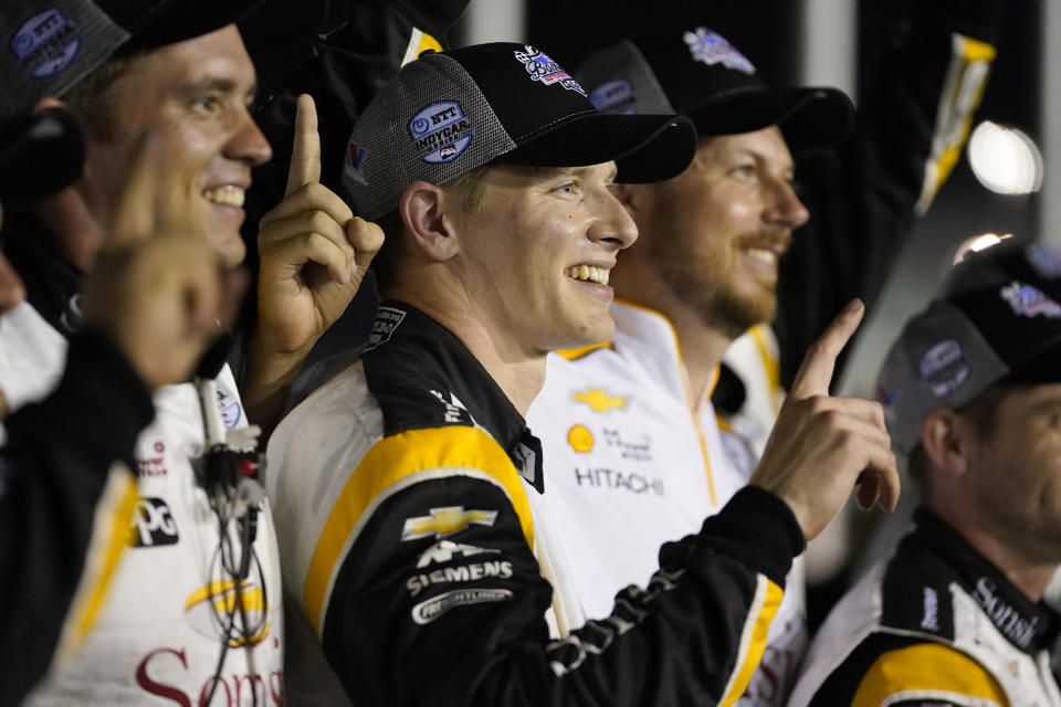 Josef Newgarden celebrates after winning an IndyCar auto race at World Wide Technology Raceway on Saturday, Aug. 21, 2021, in Madison, Ill. (AP Photo/Jeff Roberson)
