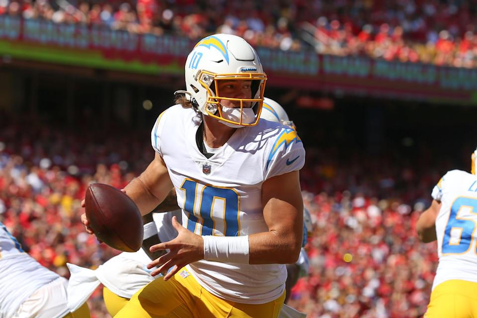 KANSAS CITY, MO - SEPTEMBER 26: Los Angeles Chargers quarterback Justin Herbert (10) rolls out in his own end zone in the first quarter of an AFC West matchup between the Los Angeles Chargers and Kansas City Chiefs on Sep 26, 2021 at GEHA Filed at Arrowhead Stadium in Kansas City, MO. (Photo by Scott Winters/Icon Sportswire via Getty Images)