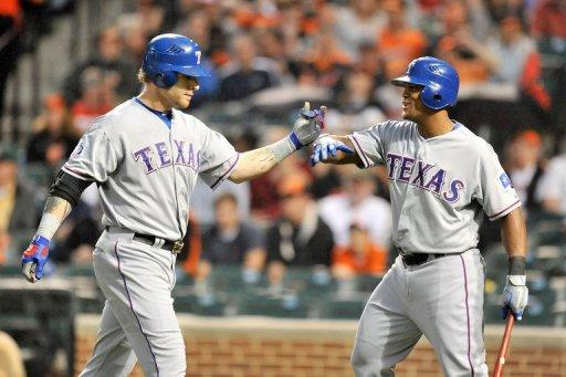 Texas Rangers' Josh Hamilton (L) celebrates with teammate Adrian Beltre after hitting a two-run home run in the third inning during the game against the Baltimore Orioles on May 8. Hamilton smacked four two-run homers and finished the game batting five-for-five