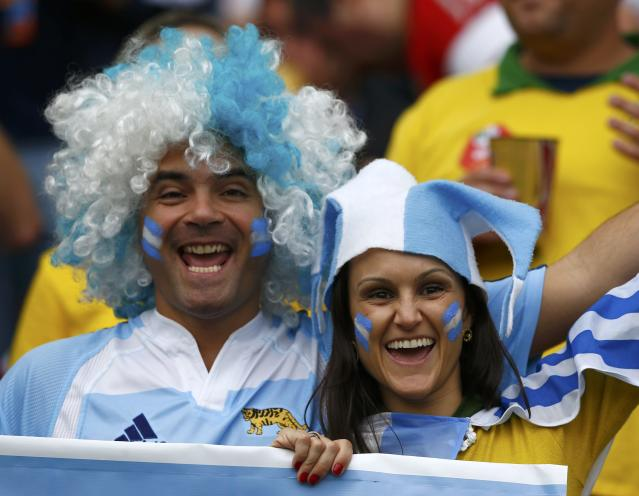 Argentina fans pose before the 2014 World Cup Group F soccer match between Argentina and Nigeria at the Beira Rio stadium in Porto Alegre June 25, 2014. REUTERS/Darren Staples (BRAZIL - Tags: SOCCER SPORT WORLD CUP)