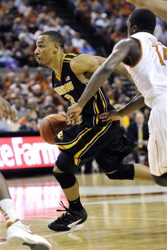 Missouri guard Matt Pressey (3) goes to the basket against Texas guard J'Covan Brown (14) during the first half of an NCAA college basketball game, Monday, Jan. 30, 2012, in Austin, Texas. (AP Photo/Michael Thomas)
