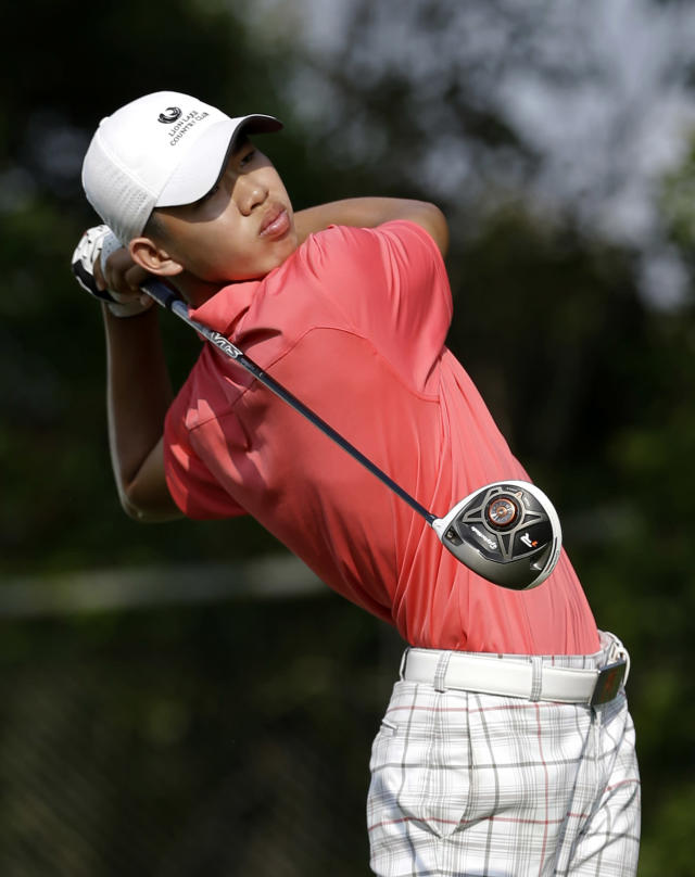 Amateur Guan Tianlang, 14, of China hits off the 15th tee during the first round of the Byron Nelson Championship golf tournament, Thursday, May 16, 2013, in Irving, Texas. (AP Photo/Tony Gutierrez)