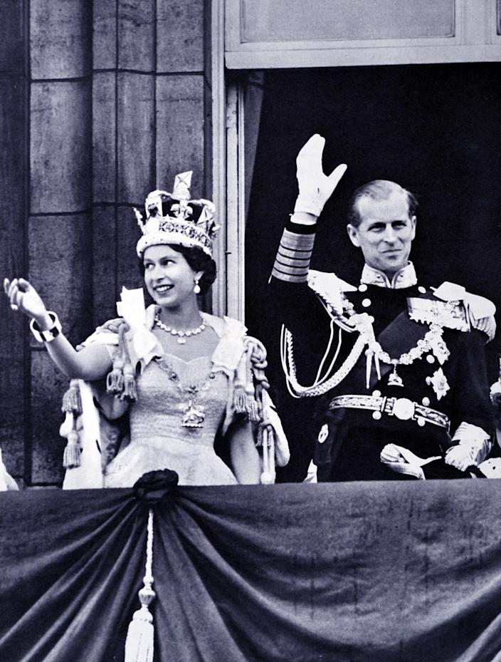 The coronation of Elizabeth II of the United Kingdom, took place on 2 June 1953 at Westminster Abbey, London. Queen Elizabeth II, with the Duke of Edinburgh, at Buckingham Palace shortly after their return from Westminster Abbey. (Photo by: Universal History Archive/Universal Images Group via Getty Images)