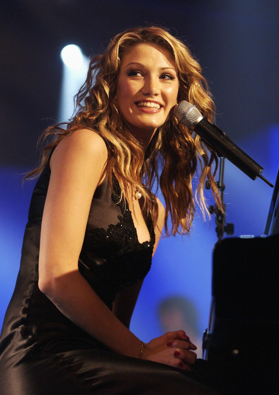 MELBOURNE - JANUARY 28:  Delta Goodrem performs during the presentation of the Allan Border Medal at the Crown Palladium Ballroom in Melbourne, Australia on January 28, 2003. The Allan Border Medal is awarded to Australia's best cricketer over the last 12 months in Tests and One-Day Internationals. (Photo by Robert Cianflone/Getty Images)
