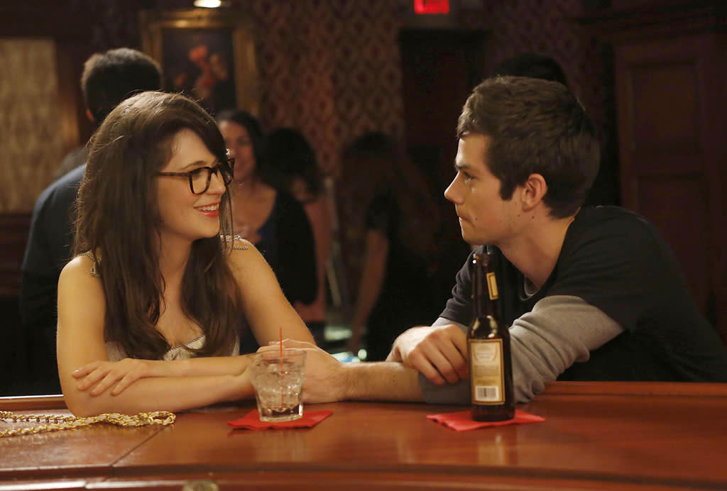 "In a flashback, guest star Dylan O'Brien reconnects with Jess (Zooey Deschanel) in the ""Virgins"" episode of ""New Girl."""