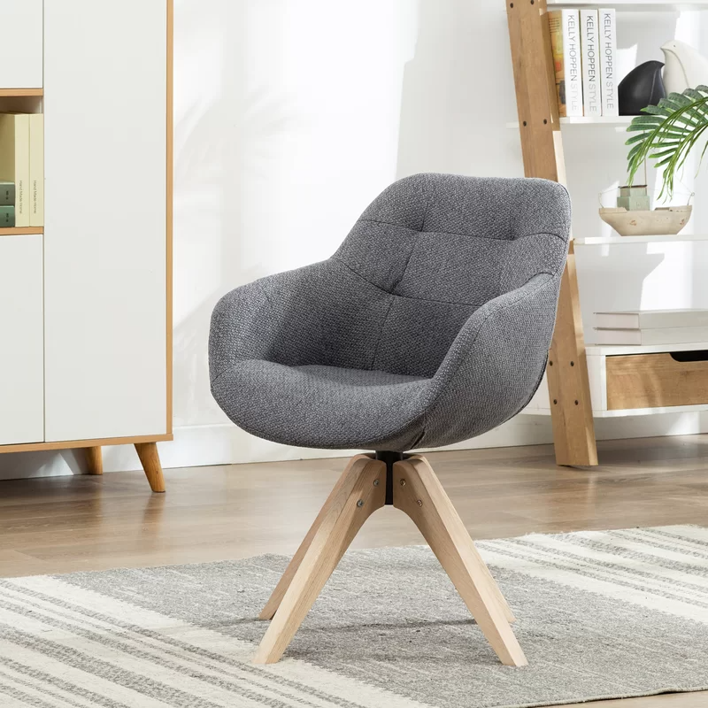 """<h3>Corrigan Studio Giacchetto Swivel Armchair</h3><br><strong>Best For: Comfy-Compact Support</strong><br>This cute cotton-blend armchair provides comfy deep-pocketed support in a compact frame that reviewers love to sit in while WFH – it also packs a stylish wheel-less frame and secret-swivel capabilities.<br><br><strong>The Hype: </strong>4.7 out of 5 stars and 109 reviews on <a href=""""https://www.wayfair.com/furniture/pdp/brayden-studio-giacchetto-swivel-armchair-w000868120.html"""" rel=""""nofollow noopener"""" target=""""_blank"""" data-ylk=""""slk:Wayfair"""" class=""""link rapid-noclick-resp"""">Wayfair</a><br><br><strong>Comfy Butts Say: </strong>""""I love the chair, it's the perfect height for my desk and it's super comfortable. The seat itself is deeper, going backward than I expected, but not a complaint at all. I highly recommend it; it's stylish and comfy."""" and """"I love it!!!! No more backaches while I work!!! Side note I wear a women's size four with a booty and thighs, the seat is not tight but it's on the smaller side for people with thick thighs and butts.""""<br><br><strong>Corrigan Studio</strong> Giacchetto Swivel Armchair, $, available at <a href=""""https://go.skimresources.com/?id=30283X879131&url=https%3A%2F%2Fwww.wayfair.com%2Ffurniture%2Fpdp%2Fcorrigan-studio-giacchetto-swivel-armchair-w003517057.html"""" rel=""""nofollow noopener"""" target=""""_blank"""" data-ylk=""""slk:Wayfair"""" class=""""link rapid-noclick-resp"""">Wayfair</a>"""
