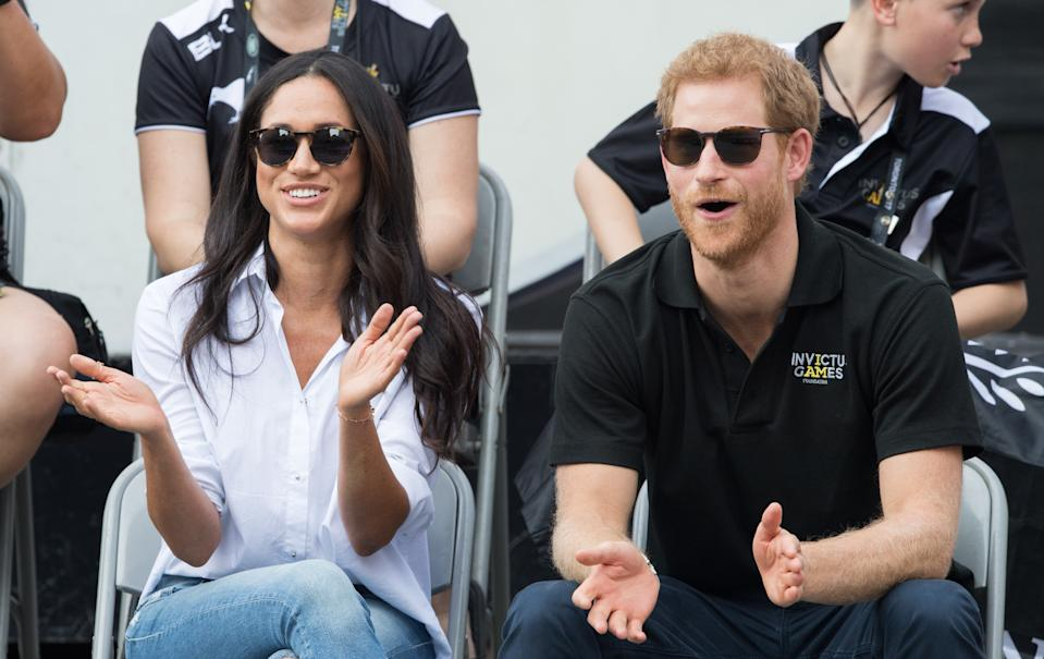 Meghan Markle and Prince Harry attend wheelchair tennis on day 3 of the Invictus Games Toronto 2017 on September 25, 2017 in Toronto, Canada.  The Games use the power of sport to inspire recovery, support rehabilitation and generate a wider understanding and respect for the Armed Forces.  (Photo by Samir Hussein/Samir Hussein/WireImage)