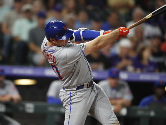 New York Mets' Pete Alonso follows through on a solo home run off Colorado Rockies pitcher Tim Melville during the sixth inning of a baseball game Tuesday, Sept. 17, 2019, in Denver. (AP Photo/David Zalubowski)