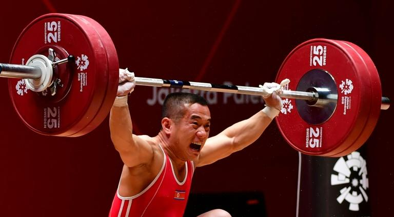 North Korean lifter Om Yun Chol, known for his exuberant celebrations, gave a reserved fist pump as he made his winning lift