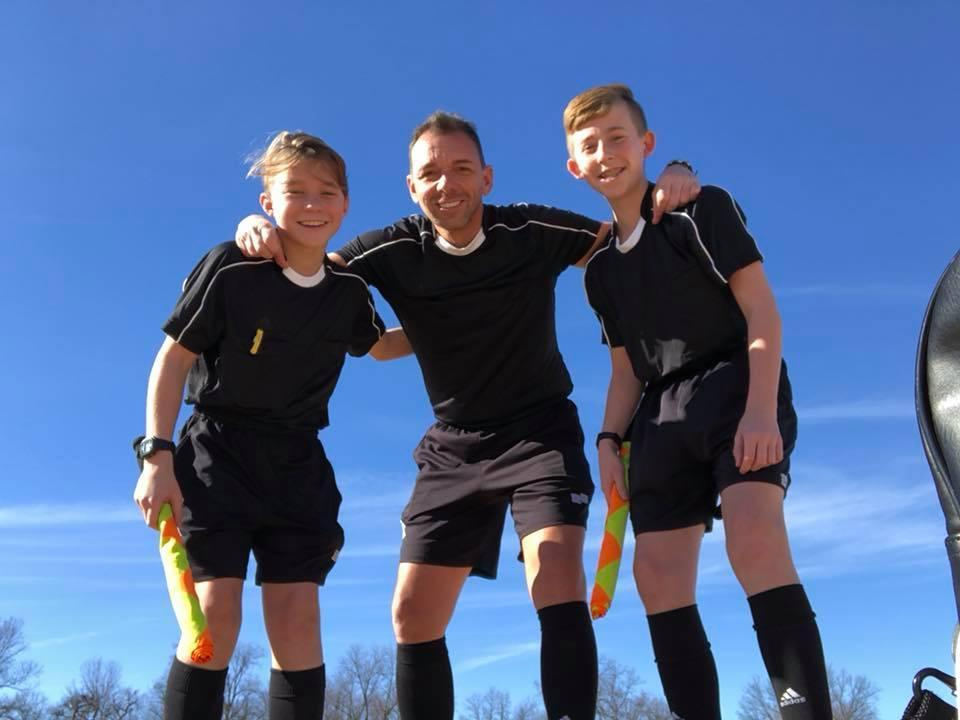 Brian Barlow alongside two youth referees. (Image: Offside via Facebook)