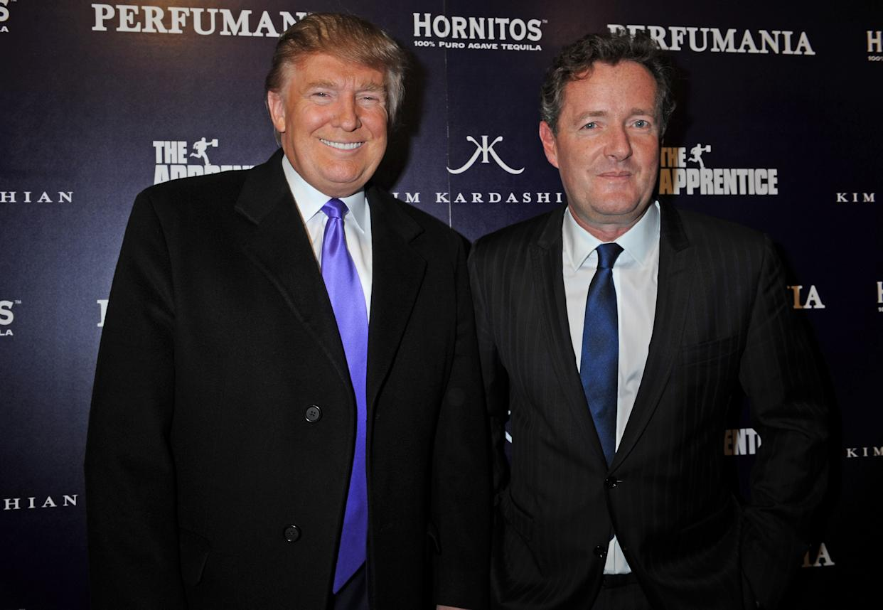 """Donald Trump, left, and Piers Morgan arrive for the Perfumania party celebrating the appearance of Kim Kardashian on the reality show """"The Apprentice"""", Wednesday, Nov. 10, 2010, in New York. (AP Photo/ Louis Lanzano)"""