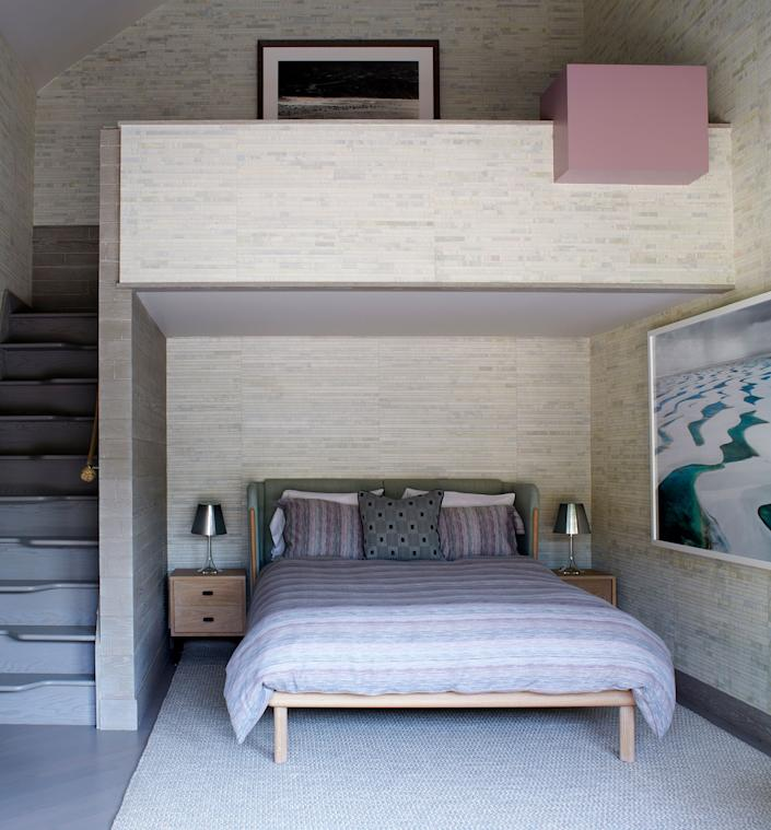 "<div class=""caption""> This bedroom, used by one of the couple's kids, has a new sleeping loft conceived by the designer to accommodate overnight guests. The downstairs bed, with its wraparound headboard, is part of the Dubois system by Luca Nichetto for <a href=""http://delaespada.com/designers/nichetto/"" rel=""nofollow noopener"" target=""_blank"" data-ylk=""slk:De La Espada"" class=""link rapid-noclick-resp"">De La Espada</a>. </div>"