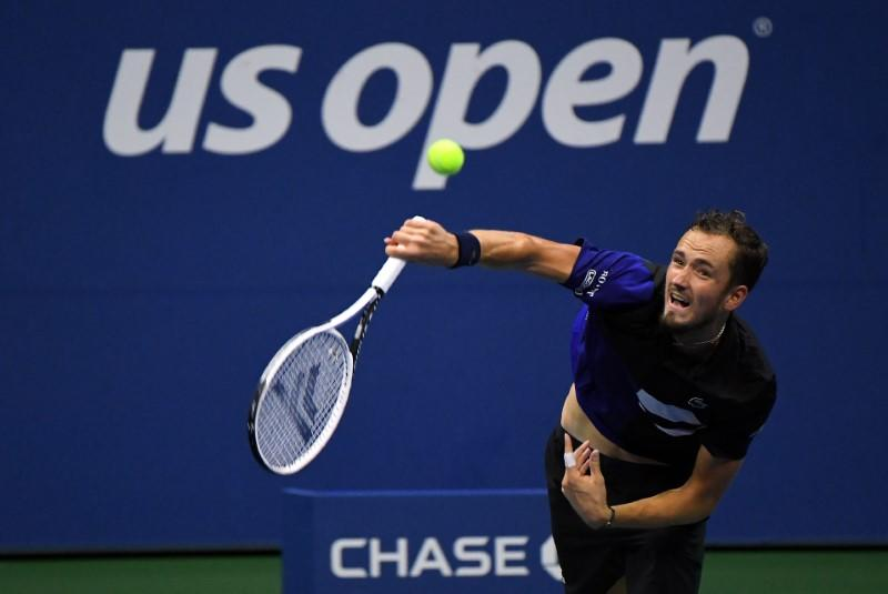 Medvedev goes for consistency over 'crazy shots' to advance