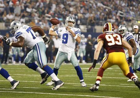 Oct 27, 2014; Arlington, TX, USA; Dallas Cowboys quarterback Tony Romo (9) throws in the pocket for a second quarter touchdown against the Washington Redskins at AT&T Stadium. Mandatory Credit: Matthew Emmons-USA TODAY Sports