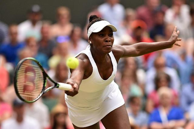 Venus Williams was defeated by her sister 6-4, 6-3 in a Wimbledon match that lasted just 67 minutes, on July 6, 2015 (AFP Photo/Leon Neal)