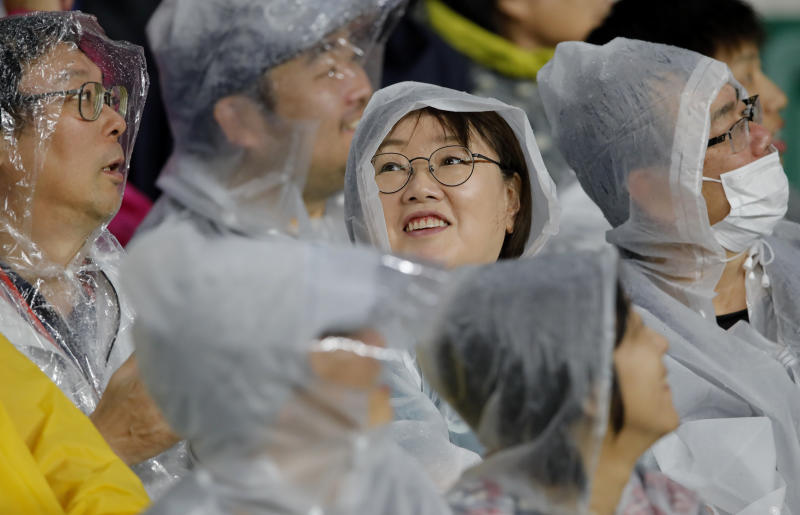Fans wait for the start of the Rugby World Cup Pool D game at Shizuoka Stadium Ecopa between Australia and Georgia in Shizuoka, Japan, Friday, Oct.11, 2019. (AP Photo/Christophe Ena)