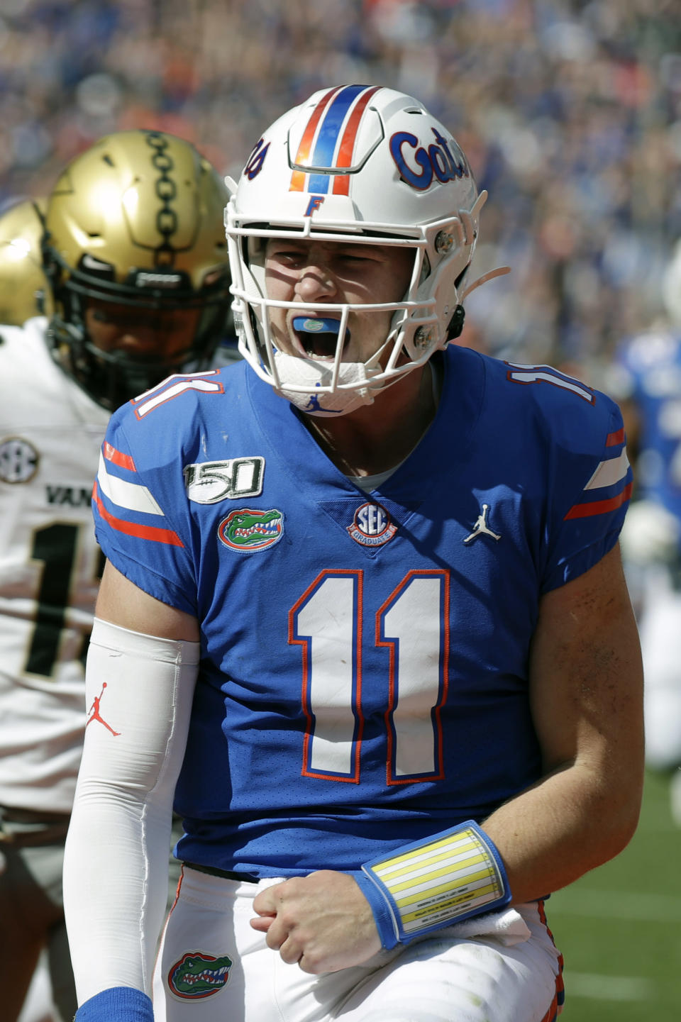 Florida quarterback Kyle Trask celebrates after scoring a touchdown on a 9-yard run against Vanderbilt during the first half of an NCAA college football game, Saturday, Nov. 9, 2019, in Gainesville, Fla. (AP Photo/John Raoux)