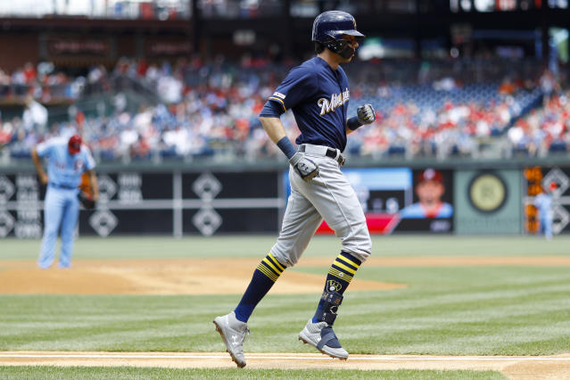 Milwaukee Brewers' Christian Yelich, right, rounds the bases after hitting a home run off Philadelphia Phillies starting pitcher Zach Eflin, left, during the first inning of a baseball game, Thursday, May 16, 2019, in Philadelphia. (AP Photo/Matt Slocum)