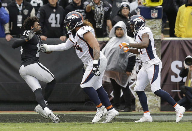 <p>Oakland Raiders wide receiver Michael Crabtree, left, fights with Denver Broncos nose tackle Domata Peko, center, and cornerback Aqib Talib during the first half of an NFL football game in Oakland, Calif., Sunday, Nov. 26, 2017. Crabtree and Talib were ejected. (AP Photo/Ben Margot) </p>
