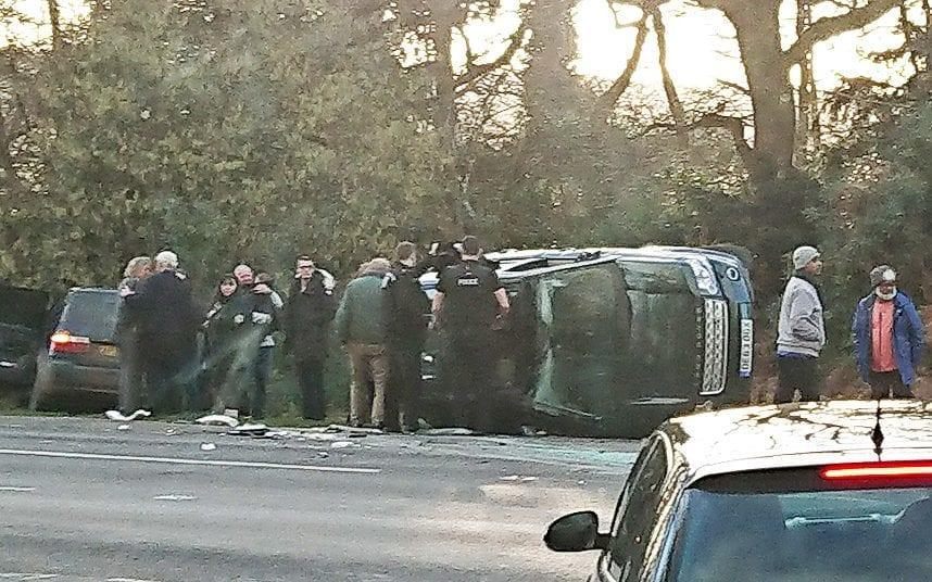 The crash site, with the Duke of Edinburgh at the centre wearing a green jacket - TELEGRAPH EXCLUSIVE