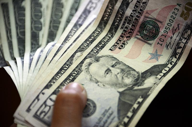 The dollar recovered against its major peers after taking a battering the previous day (AFP Photo/Juan Barreto)