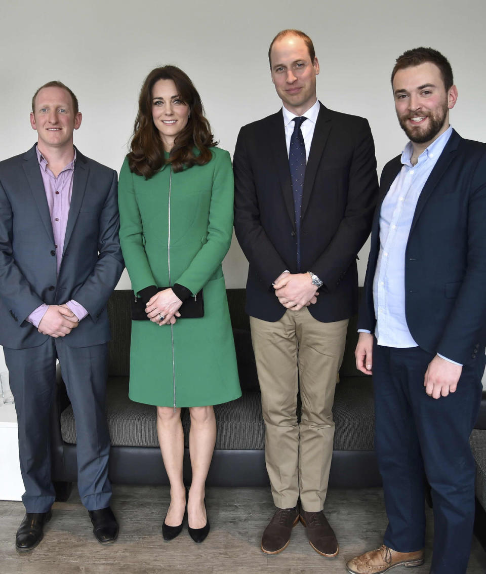 <p>For a visit to a London hospital, Kate wore a green zip-up coat by Erdem paired with a black clutch and pumps - both by Stuart Weitzman.</p><p><i>[Photo: PA]</i></p>